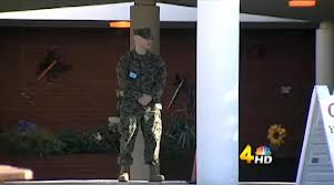 Sargent Pritchard standing guard outside of Gower Elementary School.